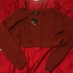 Cropped knitted sweater.